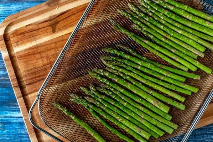 Fourth process shot  - the asparagus is ready to go in the oven.