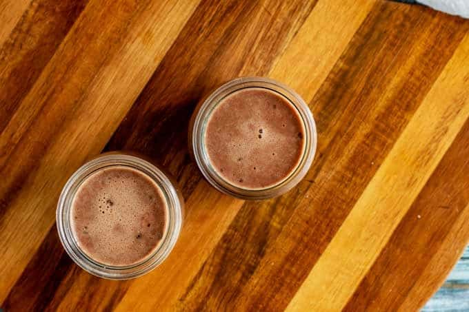 Keto Chocolate Pudding in serving containers ready for the refrigerator.