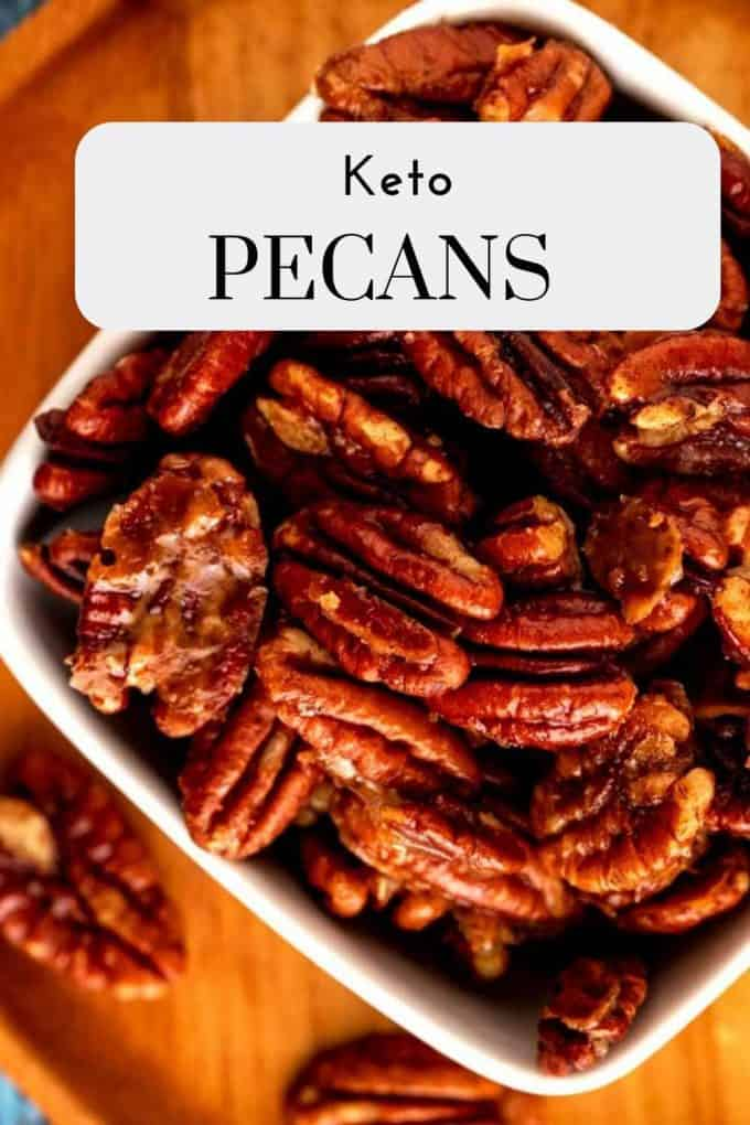 Photo of Keto Pecans in a small white bowl with the text Keto Pecans on a white overlay.