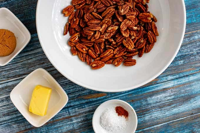 Ingredients needed to make Keto Pecans in small white prep bowls.