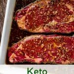 Photo of two steaks in a white baking dish covered in marinade with the text Keto Steak Marinade below it.