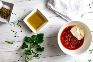 Salad dressing ingredients: seasonings, sour cream, olive oil.
