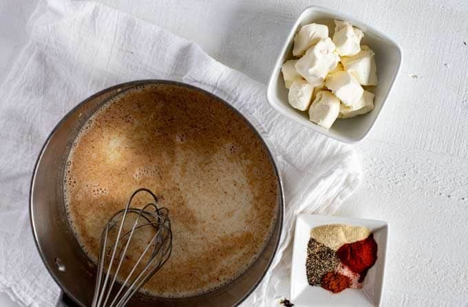 Photo of melted butter and almond flour in a sauce pan.