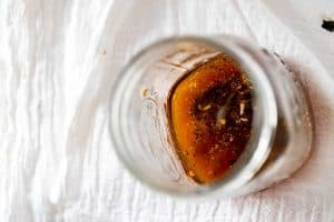 Photo of low carb salad dressing being mixed together in a jar.