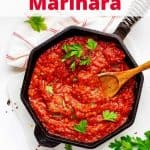 Overhead photo of Keto Marinara in a cast iron skillet with the recipe title in a text overlay above it.