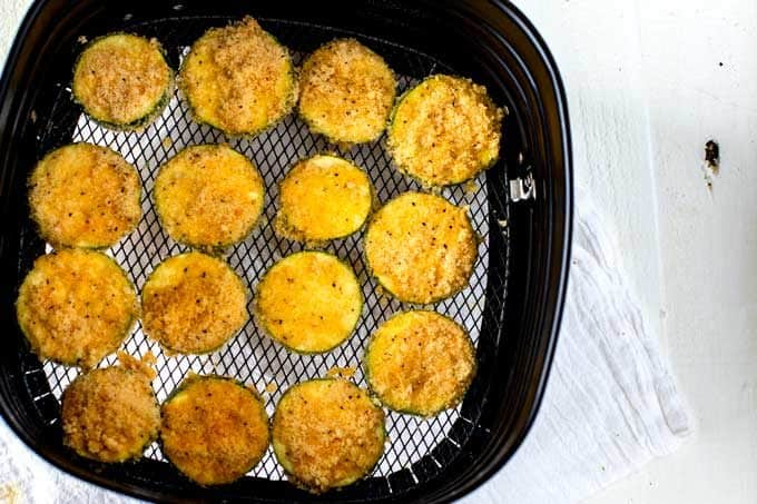 Photo of Air Fried Zucchini Chips in an air fryer.