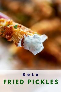 Close up photo of a fried pickle with dipping sauce on it with a text overlay that says Keto Fried Pickles.