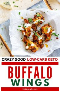 """Overhead photo of Keto Buffalo Wings on a parchment lined plate sitting on a painted cutting board with the text below """"Crazy Good Low Carb Keto Buffalo Wings"""""""
