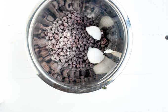 Photo of stevia sweetened chocolate chips and coconut oil in a bowl.