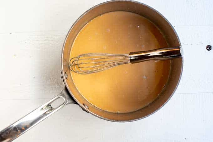 Photo of coconut oil and peanut butter melted together in a saucepan.