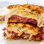 Close up square image of a Keto Reuben cut in half and stacked up on top of each other.