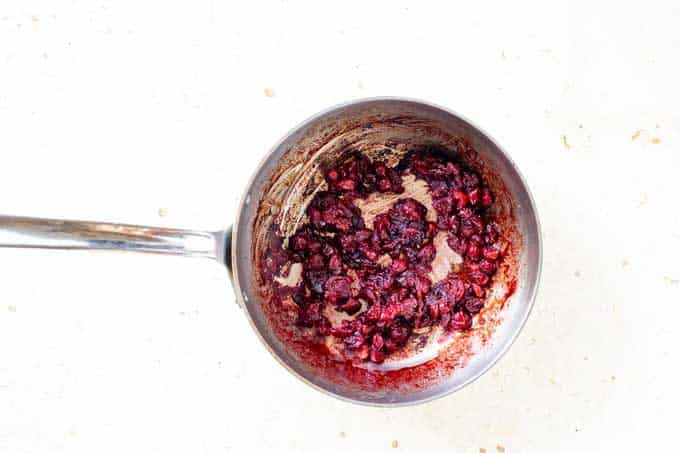 Photo of Low Carb Cranberry Sauce cooking in a saucepan.