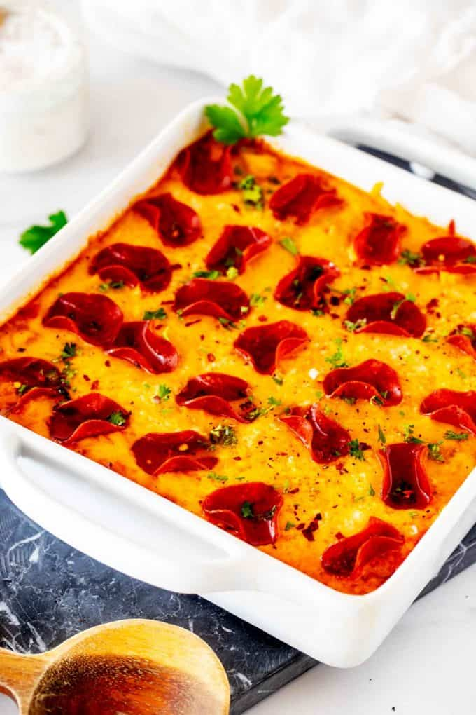Photo of a white casserole dish with Low Carb Pizza Casserole in it.