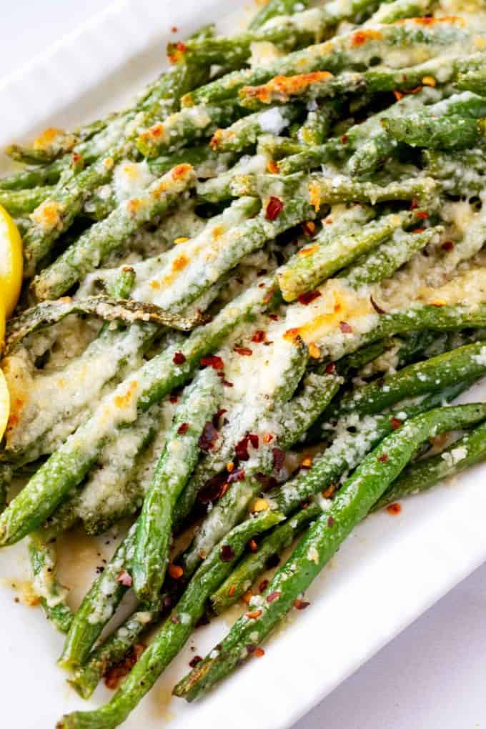 Close up photograph of low carb green beans with Parmesan cheese.