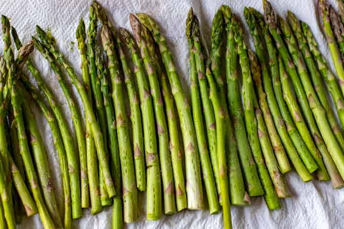 Photo of asparagus that has had holes poked in it with a fork and been salted.