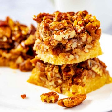 Square side photo of keto pecan bars against a white background.