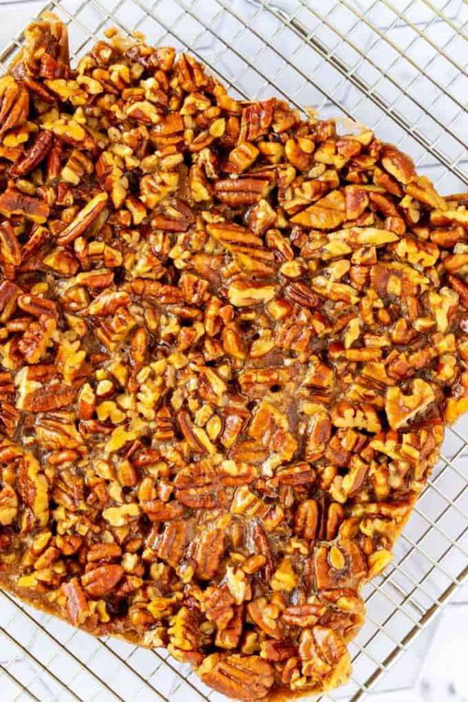 Overhead photo of keto pecan bars on a wire cooling rack.