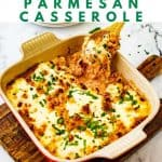 Photo of a square casserole dish with a cheesy casserole in it and the text above that says Keto Chicken Parmesan Casserole.