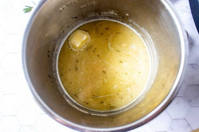 Photo of lemon rosemary sauce cooking in an Instant Pot.