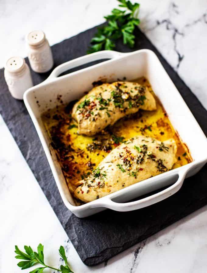 Photo of a white dish with Keto Turkey Tenderloin.