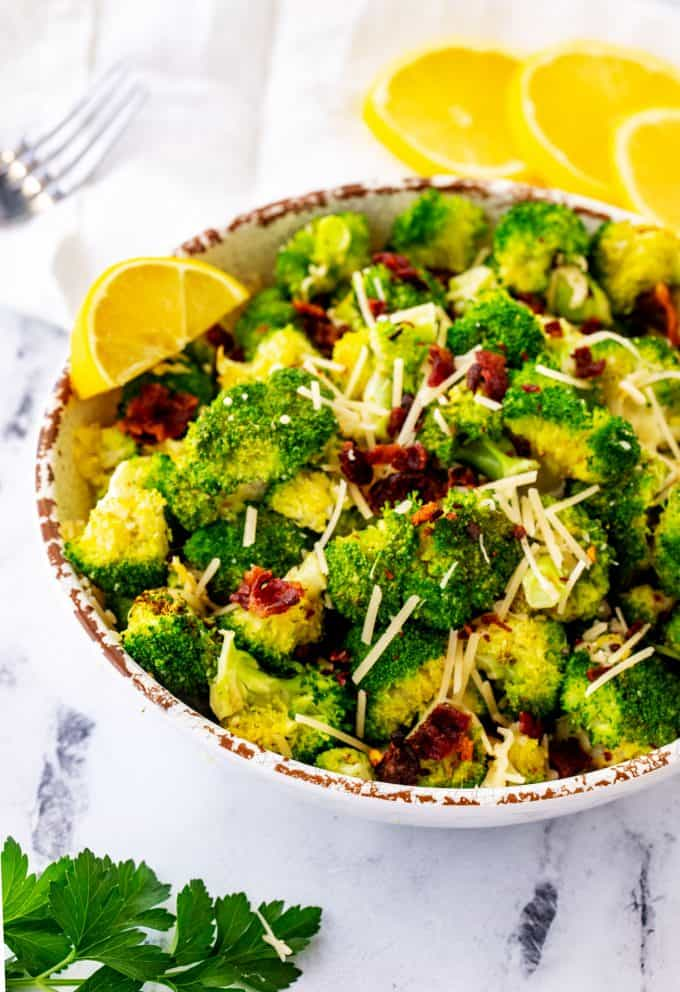Side photo of air fryer broccoli in a rustic bowl.