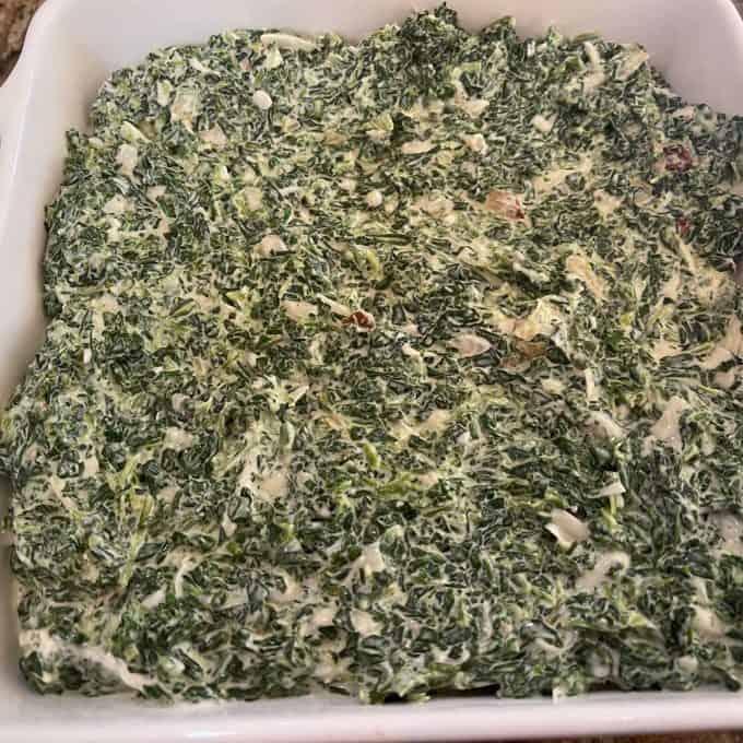 Photo of keto spinach casserole in a casserole dish.