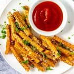 Square overhead photo of a plate of Keto Jicama Fries with a small dish of ketchup.
