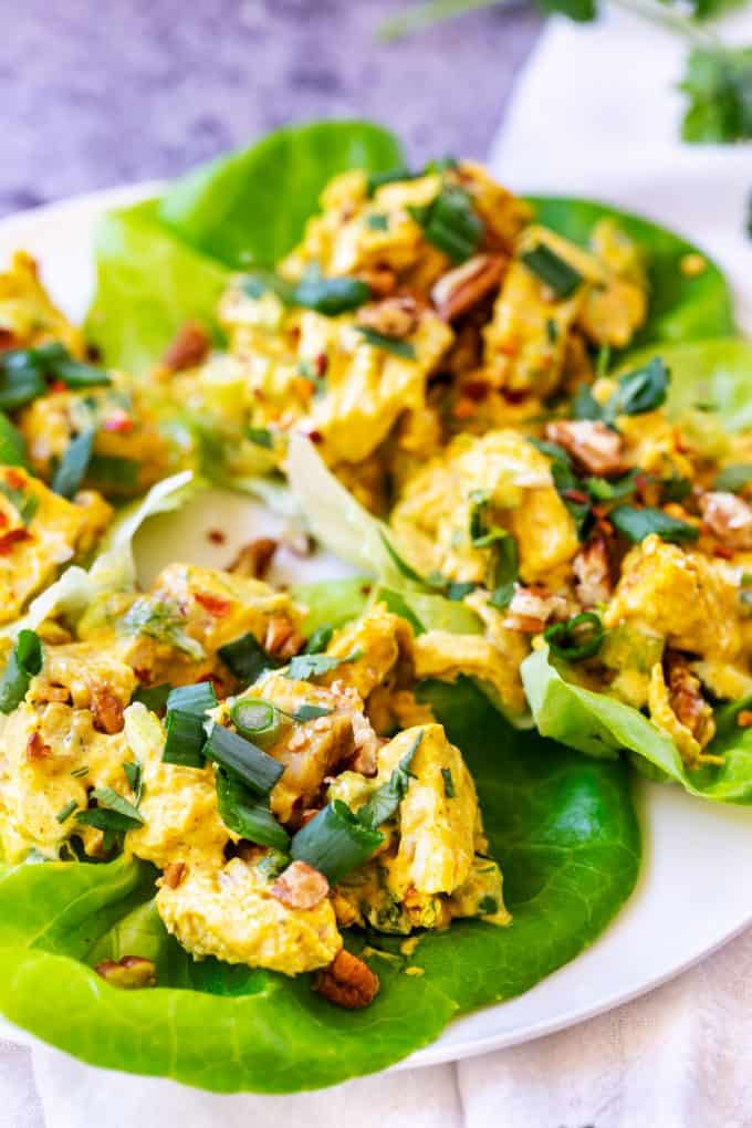 Close up photo of Keto Curry Chicken Salad in lettuce wraps.