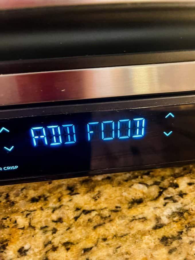 Photo of add food message in the ninja foodi grill.