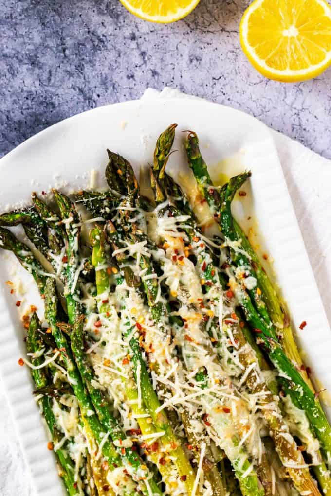 Overhead photo of a white platter with a prepared Keto Asparagus recipe.