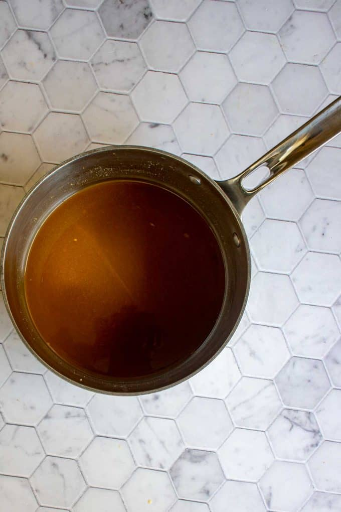 Photo of a saucepan with au jus gravy.
