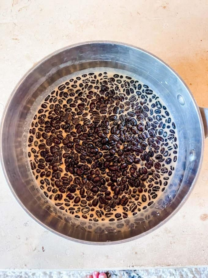 Photo of coffee beans steeping in heavy cream and sweetener.