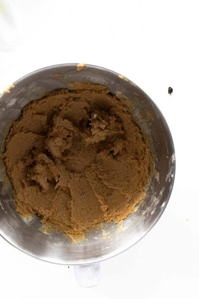 Photo of butter and sugars mixed together for cookie batter.