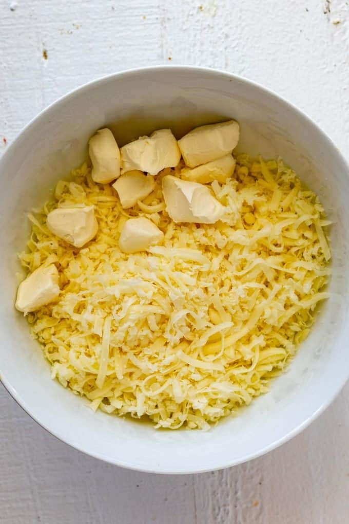 Photo of mozzarella and cream cheese in a microwave safe bowl.