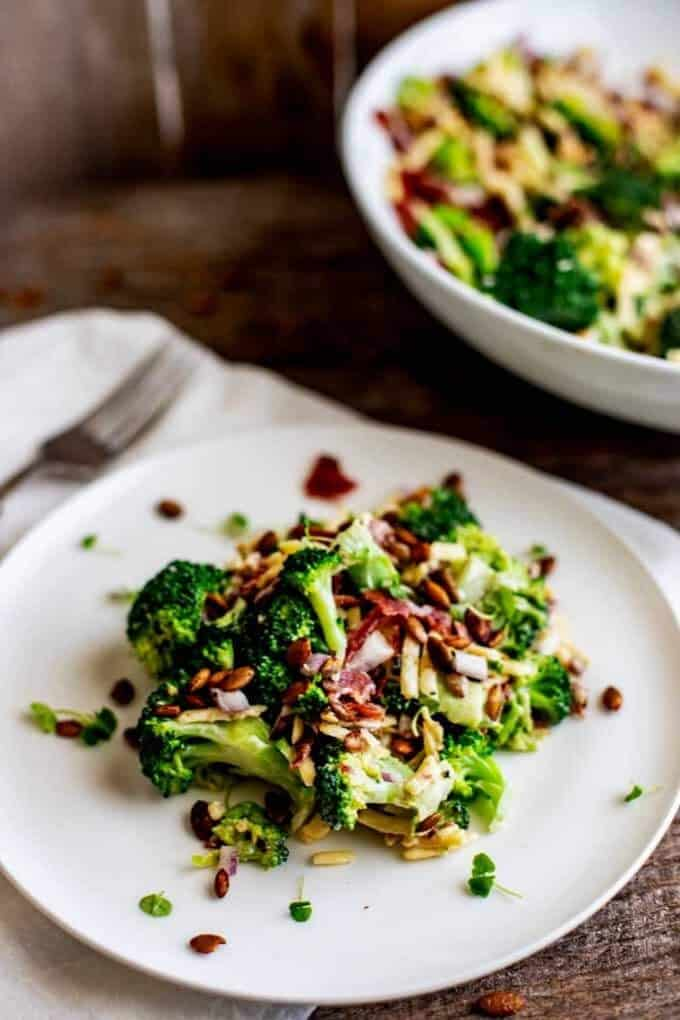 Plate of Keto Broccoli Salad with a bowl of the salad behind it.
